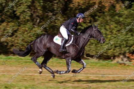 Stock Picture of Oliver Townend rides Treglider on the Cross Country course