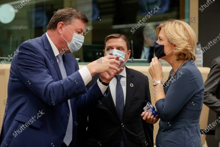 Danish Minister for Food, Agriculture and Fisheries Mogens Jensen (L), Spanish Minister of Agriculture Luis Planas (C) and German Minister of Food and Agriculture Julia Kloeckner (R) during an EU Agriculture and Fisheries Council meeting in Brussels, Belgium, 21 September 2020.