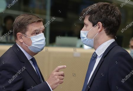 Spanish Minister of Agriculture Luis Planas, left, speaks with French Agriculture Minister Julien Denormandie during a meeting of EU agriculture ministers at the European Council building in Brussels