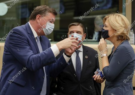 Danish Minister for Food, Agriculture and Fisheries Mogens Jensen, left, speaks with Spanish Minister of Agriculture Luis Planas, center, and German Minister of Food and Agriculture Julia Kloeckner during a meeting of EU agriculture ministers at the European Council building in Brussels