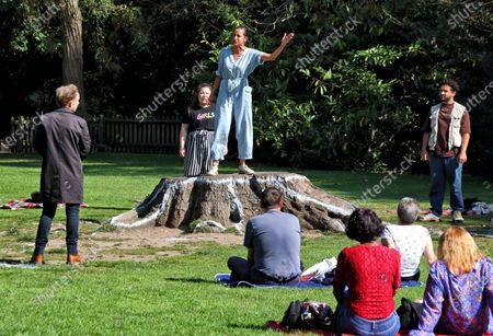 """Actress Avita Jay and other cast members perform to a socially distanced audience. The Royal Shakespeare Company has been running a series of free outdoor shows entitled """"Shakespeare Snapshots""""."""