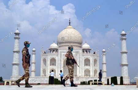 Indian security personnel stand guard at the Taj Mahal in Agra, Uttar Pradesh, India, 21 September 2020. The Taj Mahal reopened with increased safety measures after it was closed down by the authorities for six months amid the COVID-19 pandemic.