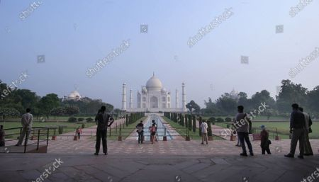 Indian tourists visit the Taj Mahal in Agra, Uttar Pradesh, India, 21 September 2020. The Taj Mahal reopened with increased safety measures after it was closed down by the authorities for six months amid the COVID-19 pandemic.