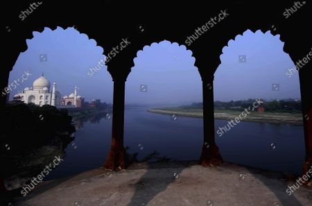 The Taj Mahal monument is seen on the banks of the river Yamuna early morning in Agra, India, Monday, Sept.21, 2020. Taj Mahal reopened after being closed for more than six months due to the coronavirus pandemic