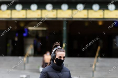 A woman crosses the street during COVID-19 in Melbourne, Australia.  Victoria recorded only 11 new cases overnight and two deaths, despite this Premier Daniel Andrews continues to refuse to ease restrictions. Meanwhile Melbournians are suffering lockdown fatigue, businesses are closing and mental health is suffering an upsurge.