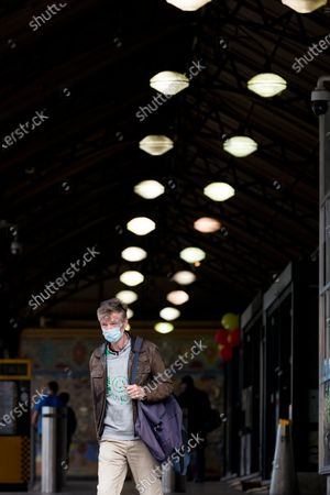 A man wearing a mask is seen in Flinders Street Station during COVID-19 in Melbourne, Australia.  Victoria recorded only 11 new cases overnight and two deaths, despite this Premier Daniel Andrews continues to refuse to ease restrictions. Meanwhile Melbournians are suffering lockdown fatigue, businesses are closing and mental health is suffering an upsurge.