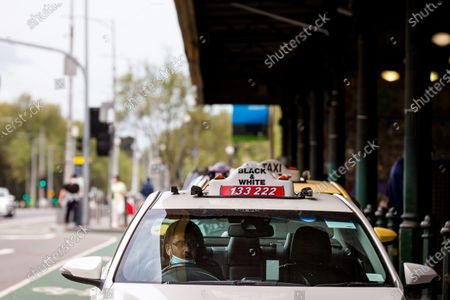 Despite the city being virtually empty, many taxi's line up at Flinders Street Station during COVID-19 in Melbourne, Australia.  Victoria recorded only 11 new cases overnight and two deaths, despite this Premier Daniel Andrews continues to refuse to ease restrictions. Meanwhile Melbournians are suffering lockdown fatigue, businesses are closing and mental health is suffering an upsurge.