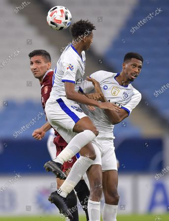 Nasser Al-Dawsari (C) and Mohamed Kanno (R) of AL Hilal vie for the ball with Akbar Sadeghi of Shahr Khodro FC during the AFC Asian Champions League group B football match between Al Hilal SFC of Saudi Arabia and Shahr Khodro FC of Iran at Al-Janoub Stadium in Doha, capital of Qatar, Sept. 20, 2020.