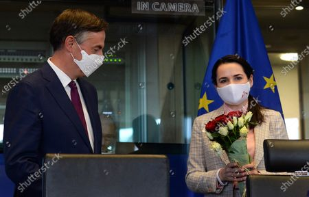 Belarusian opposition leader Sviatlana Tsikhanouskaya (R) stands next to member of the European Parliament David James McAllister (L) before speaking to the members of the European Parliament's Foreign Affairs committee, at the EU Parliament in Brussels, Belgium, 21 September 2020.