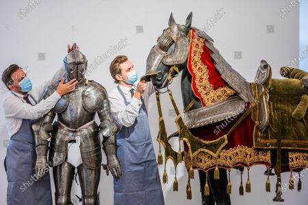 Arkistovalokuva kohteesta An Equestrian Full Armour For Man And Horse, in Mid-Late 16th Century Style (the Breast- And Back-Plate Late 16th Century, the remainder 19th Century), est£10,000 - 15,000 - Preview of Bonhams' Antique Arms and Armour sale at their Knightsbridge saleroom. The sale will take place on Wednesday 23 September