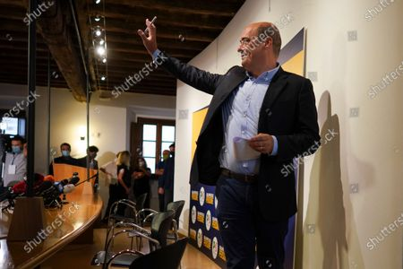Democratic Party leader Nicola Zingaretti waves as he leaves at the end of a press conference, in Rome, . On Sunday and Monday Italians voted nationwide in a referendum to confirm a historical change to the country's constitution to drastically reduce the number of Members of Parliament from 945 to 600. Eighteen million of Italian citizens will also vote on Sunday and Monday to renew local governors in seven regions, along with mayors in approximately 1,000 cities