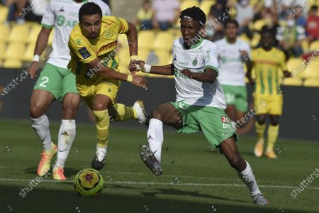 Nantes' Brazilian defender Fabio da Silva vies for the ball with Saint Etienne's Cameroonian midfielder Yvan Neyou during the L1 football match between Nantes (FC Nantes) and Saint-Etienne