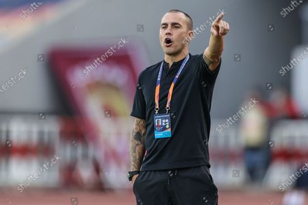 Fabio Cannavaro, head coach of Guangzhou Evergrande Taobao, reacts during the 12th round match between Guangzhou Evergrande Taobao and Henan Jianye at the postponed 2020 season Chinese Football Association Super League (CSL) Dalian Division in Dalian, northeast China's Liaoning Province, Sept. 21, 2020.