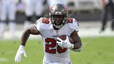 Tampa Bay Buccaneers running back Leonard Fournette (28) runs during the second half of an NFL football game against the Carolina Panthers, in Tampa, Fla