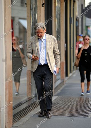 Author, Paolo Del Debbio walks through the streets of the center.