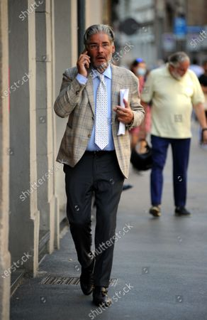 Stock Picture of Author, Paolo Del Debbio walks through the streets of the center.