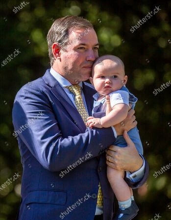 Hereditary Grand Duke Guillaume of Luxembourg holding Prince Charles poses for a photo during a ceremony to plant a tree in honor of birth of His Royal Highness Prince Charles, in Luxembourg, 21 September 2020. HRH Prince Charles Jean Philippe Joseph Marie Guillaume of Luxembourg was born on 10 May 2020 in Luxembourg.