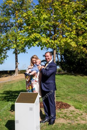 Hereditary Grand Duke Guillaume of Luxembourg (R) stands next to Hereditary Grand Duchess Stephanie of Luxembourg holding Prince Charles as they pose for a photo during a ceremony to plant a tree in honor of birth of His Royal Highness Prince Charles, in Luxembourg, 21 September 2020. HRH Prince Charles Jean Philippe Joseph Marie Guillaume of Luxembourg was born on 10 May 2020 in Luxembourg.