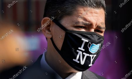 New York City Schools Chancellor Richard Carranza wears a mask during a news conference at the Mosaic Pre-K Center on the first day of school, in New York. The city public schools delayed reopening for two weeks