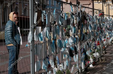 A man views a makeshift memorial to medical workers that have died from COVID-19, in front of the local health department in central St. Petersburg, Russia, 21 September 2020. In the past 24 hours Russia registered 6,196 new cases caused by the SARS-CoV-2 coronavirus infection and 71 coronavirus-related deaths.
