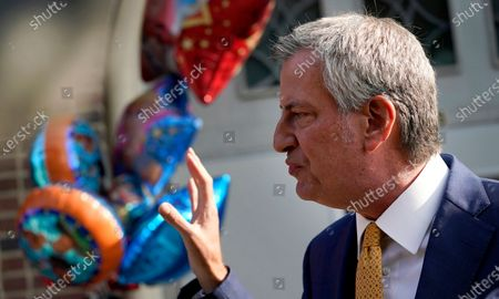 New York Mayor Bill de Blasio talks during a news conference outside the Mosaic Pre-K Center on the first day of school, in New York. The city public schools delayed reopening for two weeks