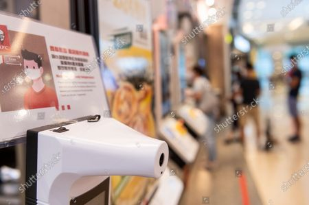A thermal automatic machine, to check the temperature of clients as a precaution against Coronavirus (COVID-19 virus), is seen at the American fast food chicken restaurant chain Kentucky Fried Chicken (KFC) in Hong Kong