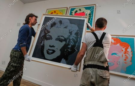 Workers install  'Marilyn Monroe' artworks by US Pop artist Andy Warhol for an exhibition 'Me, Andy Warhol', at New Tretyakov Gallery in Moscow, Russia, 21 September 2020. The exhibit, which features 200 artworks, will run from 25 September to 10 January 2021.