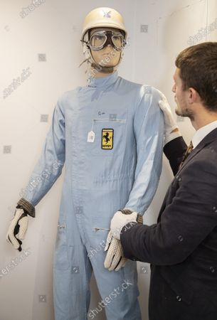 Also included in the specialist sale is a race suit worn by Sir Stirling Moss.   A Ferrari F1 simulator has been put up for sale to give wannabe racing drivers the chance to take part in a Grand Prix from the comfort of their own living room.  The device replicates the feeling of being behind the wheel of a Formula 1 car from behind three large screens.