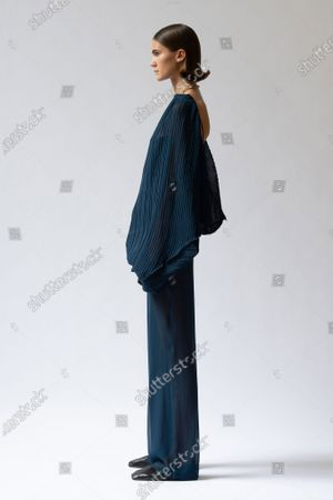 Stock Image of A Model wearing an outfit from the Womens Ready to wear, pret a porter, collections, summer 2021, original creation, during the Womenswear Fashion Week in London, from the house of Sharon Wauchob