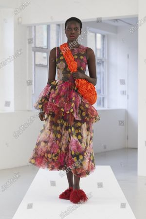 A Model wearing an outfit from the Womens Ready to wear, pret a porter, collections, summer 2021, original creation, during the Womenswear Fashion Week in London, from the house of Molly Goddard