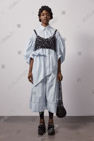 A Model wearing an outfit from the Womens Ready to wear, pret a porter, collections, summer 2021, original creation, during the Womenswear Fashion Week in London, from the house of Simone Rocha