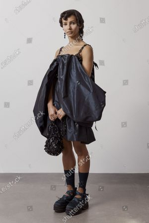 Stock Picture of A Model wearing an outfit from the Womens Ready to wear, pret a porter, collections, summer 2021, original creation, during the Womenswear Fashion Week in London, from the house of Simone Rocha