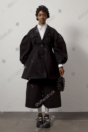 Stock Photo of A Model wearing an outfit from the Womens Ready to wear, pret a porter, collections, summer 2021, original creation, during the Womenswear Fashion Week in London, from the house of Simone Rocha