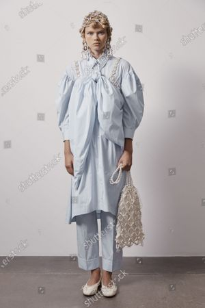 Stock Image of A Model wearing an outfit from the Womens Ready to wear, pret a porter, collections, summer 2021, original creation, during the Womenswear Fashion Week in London, from the house of Simone Rocha