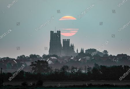 Hazy start to the day at Ely in Cambridgeshire on Sunday morning before the clear skies arrive with another sunny day forecast.