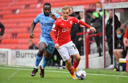 Barnsley's Luke Thomas on the ball from Coventry's Fantaky Dabo.