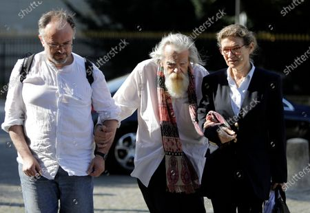 """Stock Photo of French/British actor Michael Lonsdale, center, arrives for the funeral of French film director Jean Pierre Mocky at Saint Sulpice church in Paris. Michael Lonsdale, a French-British actor and giant of the silver screen and theatre in France, died on Monday, his agent said. From his role as villain in the 1979 James Bond film """"Moonraker"""" to that of a monk in Algeria in """"Of Gods and Men,"""" Lonsdale worked, often in second roles, with top directors from Orson Wells to Spielberg"""