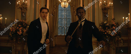 Harris Dickinson as Conrad and Djimon Hounsou as Shola