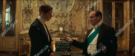 Stock Image of Harris Dickinson as Conrad and Ralph Fiennes as Duke of Oxford
