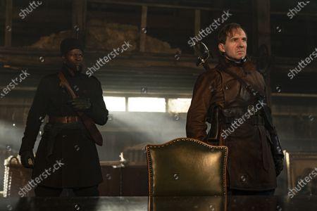 Djimon Hounsou as Shola and Ralph Fiennes as Duke of Oxford