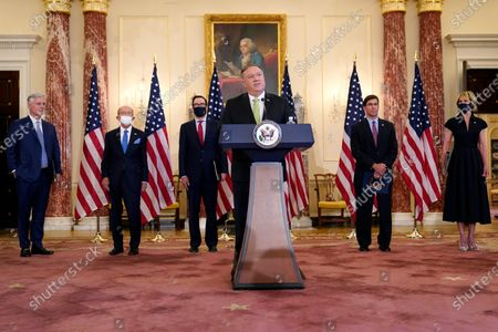 Secretary of State Mike Pompeo speaks during a news conference to announce the Trump administration's restoration of sanctions on Iran, at the U.S. State Department in Washington. Standing behind Pompeo are from left, National Security Adviser Robert O'Brien, Commerce Secretary Wilbur Ross, Treasury Secretary Steve Mnuchin, Defense Secretary Mark Esper and U.S. Ambassador to the United Nations Kelly Craft