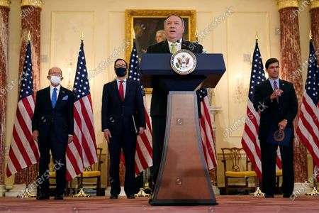 Secretary of State Mike Pompeo speaks during a news conference to announce the Trump administration's restoration of sanctions on Iran, at the U.S. State Department in Washington. Standing behind Pompeo from left are Commerce Secretary Wilbur Ross, Treasury Secretary Steve Mnuchin, and Defense Secretary Mark Esper