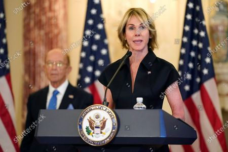 Stock Photo of Ambassador to the United Nations Kelly Craft speaks during a news conference to announce the Trump administration's restoration of sanctions on Iran, at the U.S. State Department in Washington. Standing behind Craft is Commerce Secretary Wilbur Ross