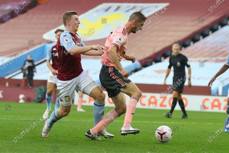 Stock Photo of Aston Villa's Matt Targett fouls Sheffield United's Jack O'Connell in the penalty area during the English Premier League soccer match between Aston Villa and Sheffield United at the Villa Park stadium in Birmingham