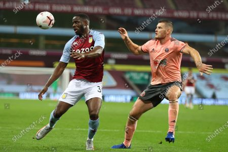 Aston Villa's Keinan Davis, left, challenges for the ball with Sheffield United's Jack O'Connell during the English Premier League soccer match between Aston Villa and Sheffield United at the Villa Park stadium in Birmingham