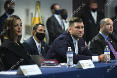 Stock Image of Tim Tebow and wife Demi-Leigh Tebow (L) listen as US Attorney General William Barr and advisor to the President Ivanka Trump meet with federal officials and stakeholders at the U.S. Attorney's Office for the Northern District of Georgia, during a panel discussion on public and private partnerships and the business community's role in combatting human trafficking, held in Atlanta, Georgia, USA, 21 September 2020.