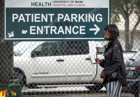 Stock Image of A woman walks in front of the entrance of University of Miami Hospital in Miami, Florida, USA, 21 September 2020.