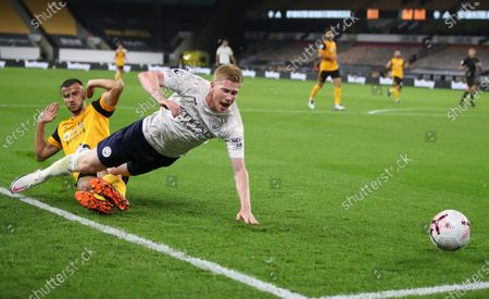 Manchester City's Kevin De Bruyne reacts as he is fouled by Wolverhampton Wanderers' Romain Saiss during the English Premier League soccer match between Wolverhampton Wanderers and Manchester City at Molineux Stadium in Wolverhampton, England