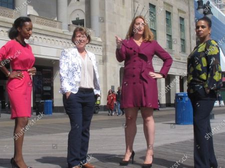 Stock Image of The four women who run Atlantic City casinos pose for photos on the Atlantic City N.J. Boardwalk on : From left, to right they are: Jacqueline Grace of Tropicana; Terry Glebocki of Ocean Casino Resort; Karie Hall of Bally's, and Melonie Johnson of Borgata. Four of Atlantic City's nine casinos are run by women