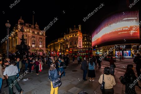 Editorial image of I Saw The World End by Es Devlin and Machiko Weston on the Piccadilly Lights to mark United Nations International Day of Peace., Piccadilly Circus, London, UK - 21 Sep 2020